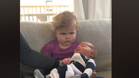 Toddler who's unimpressed with new baby brother is all of us when big change comes