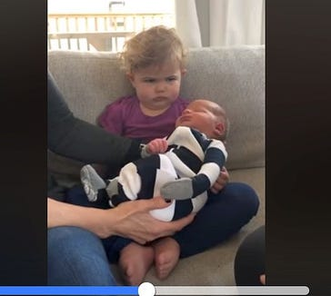 This toddler seems less than impressed with his new sibling.
