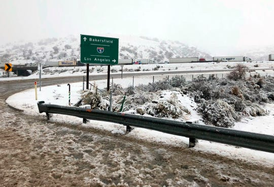 This photo provided by the California Department of Transportation (CalTrans) shows a ramp to Interstate 5 after it was closed due to snow Monday at Tejon Pass, an area known as the Grapevine, at Gorman in the Tehachapi Mountains.