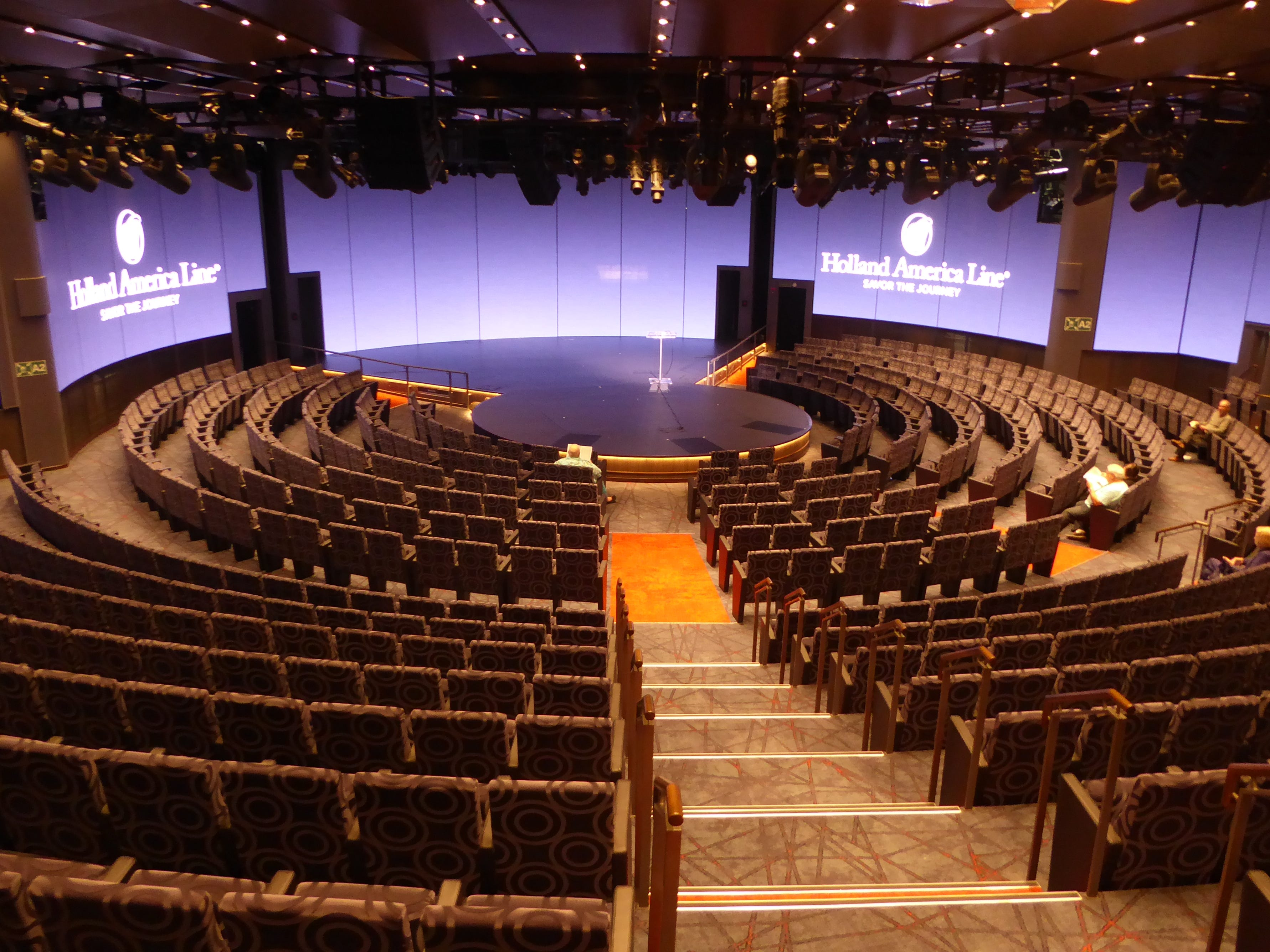 The 667-seat World Stage is the Nieuw Statendam's largest indoor entertainment venue, featuring an in-the-round stage and state-of-the-art, floor-to-ceiling video screens.  It begins two full decks of public spaces on Decks 3 and 2.