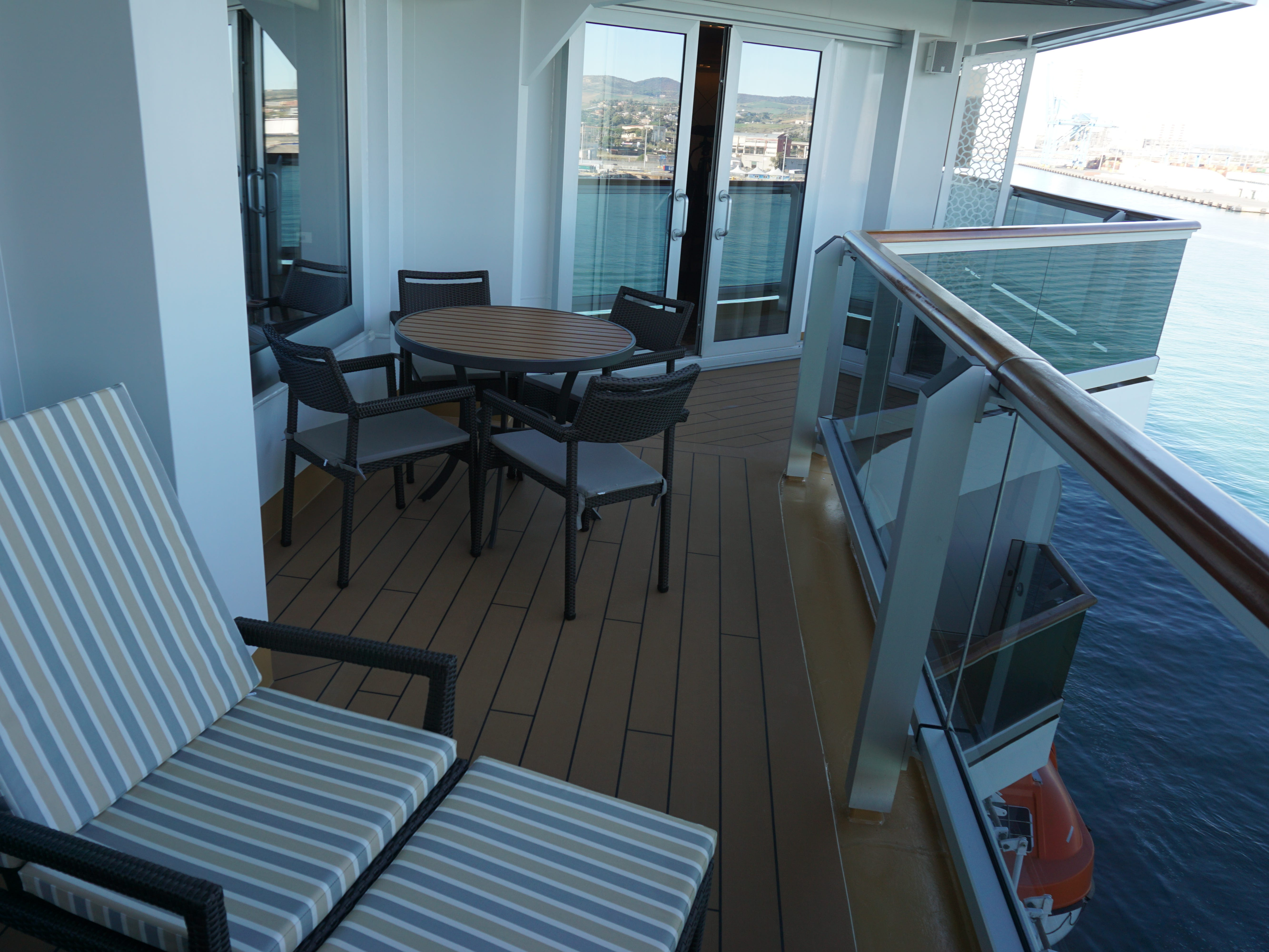 This portion of the Pinnacle Suite's balcony has loungers and a dining nook.