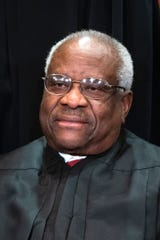 Associate Justice Clarence Thomas wrote the Supreme Court's 5-4 opinion upholding a criminal defendant's enhanced sentence for a gun crime.