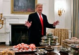 In honor of winning the 2018 college football championship, the Clemson Tigers were treated to a fast food catered White House visit by President Donald Trump on Jan. 14.