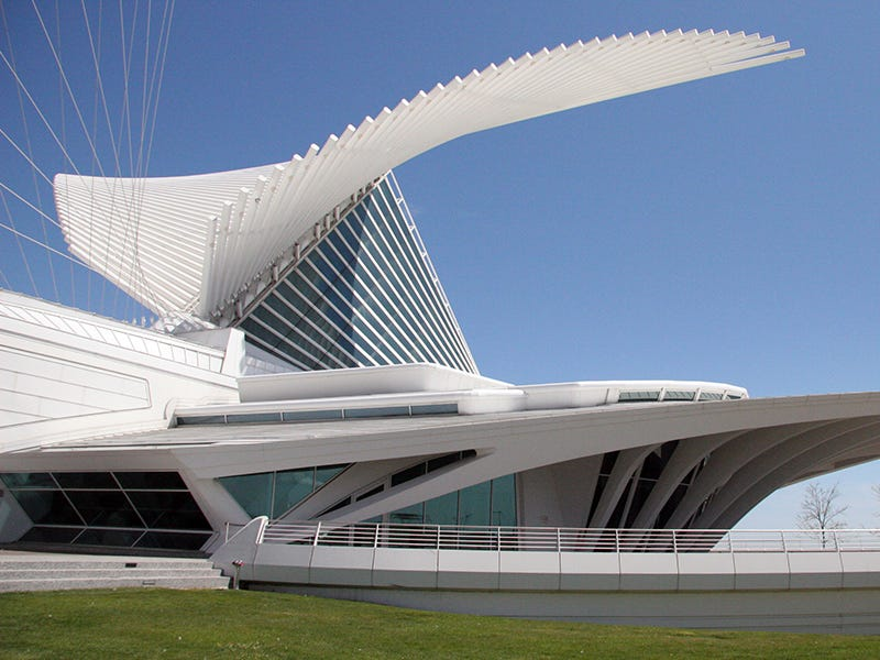 Quadracci Pavilion at Milwaukee Art Museum: The wings on Milwaukee Art Museum's Quadracci Pavilion open each morning, flap at noon and close in the evening. Designed by Santiago Calatrava, the building features a reception hall with flying buttresses and a glass ceiling, plus a suspension bridge leading into the city.
