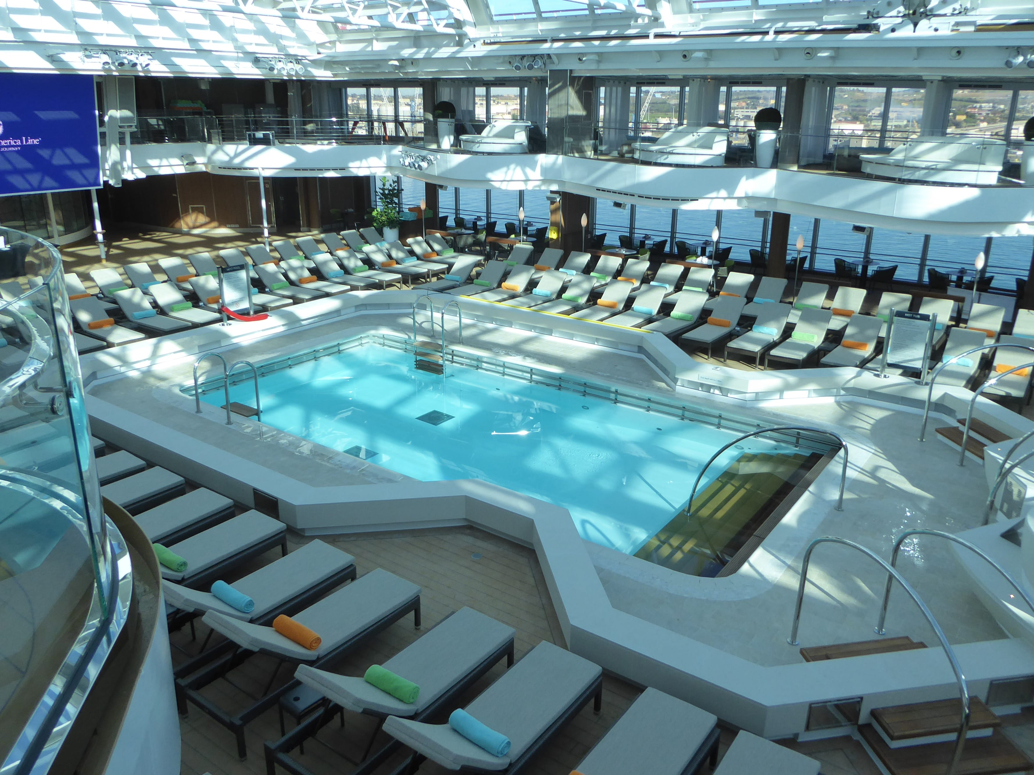On Deck 10, a terrace lined with cabanas overlooks the midships Lido Pool.
