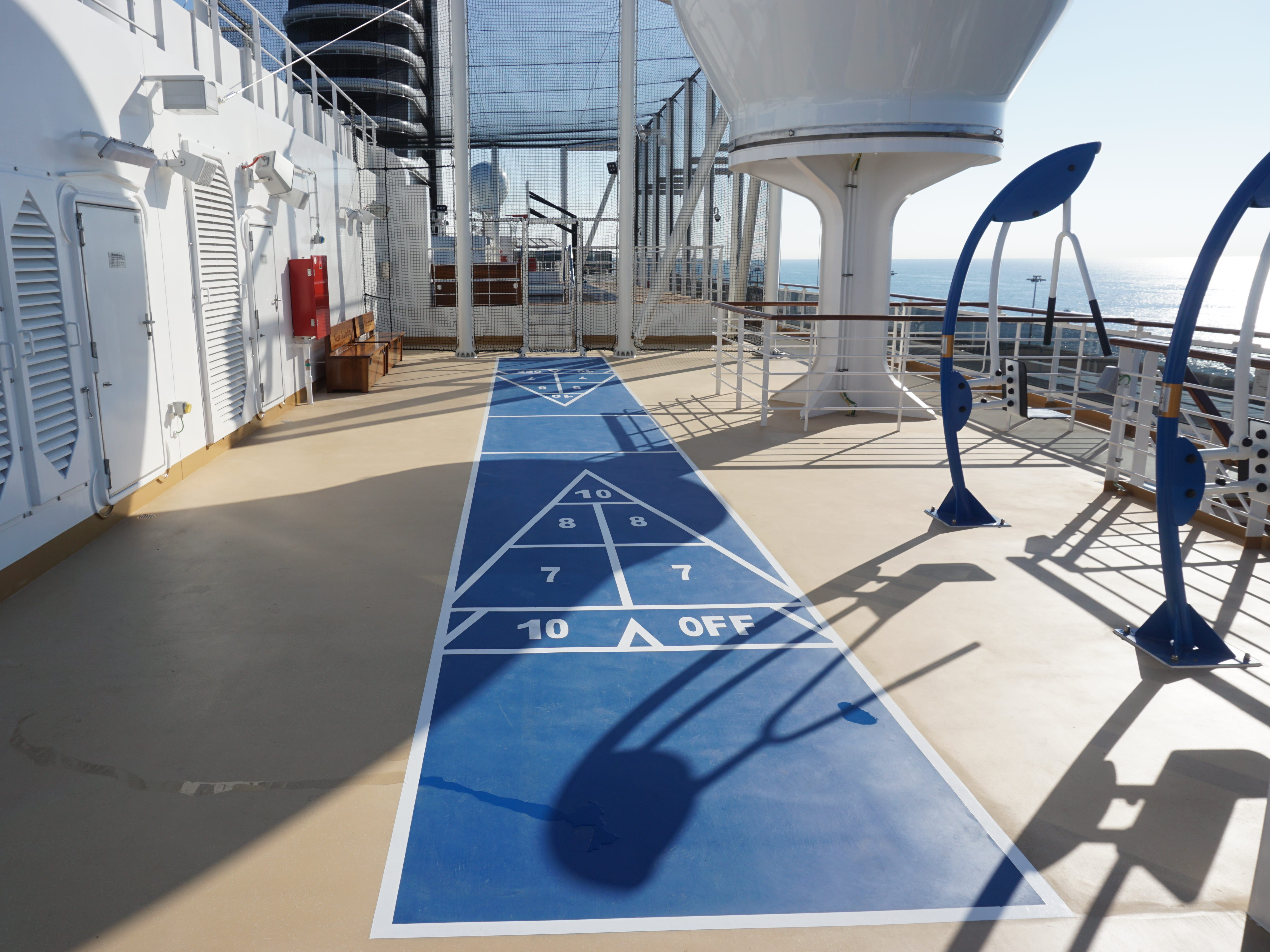 Aft of the jogging track on Deck 11, there are shuffleboard courts.