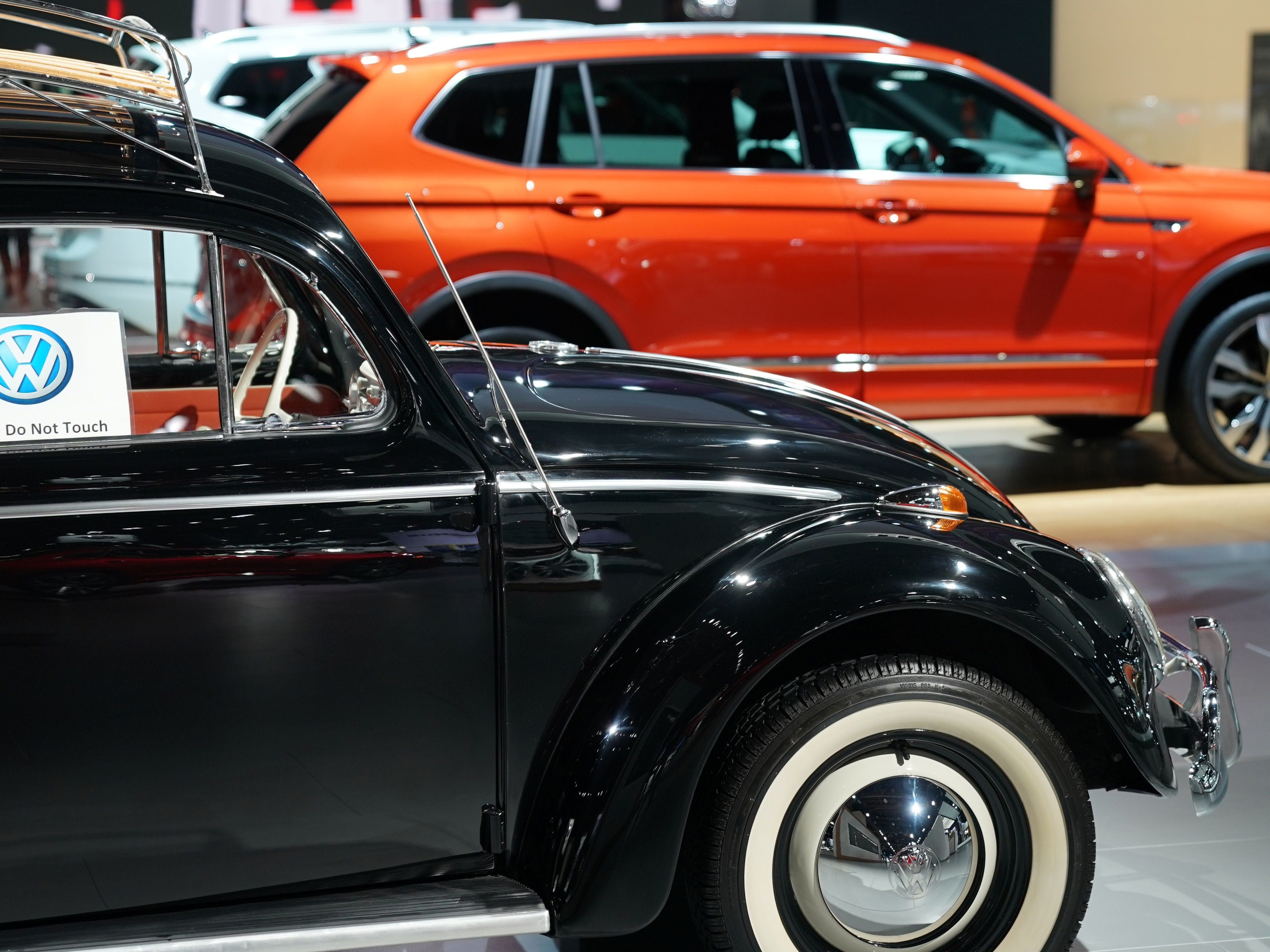 A 1964 VW Beetle is on display in the VW area.