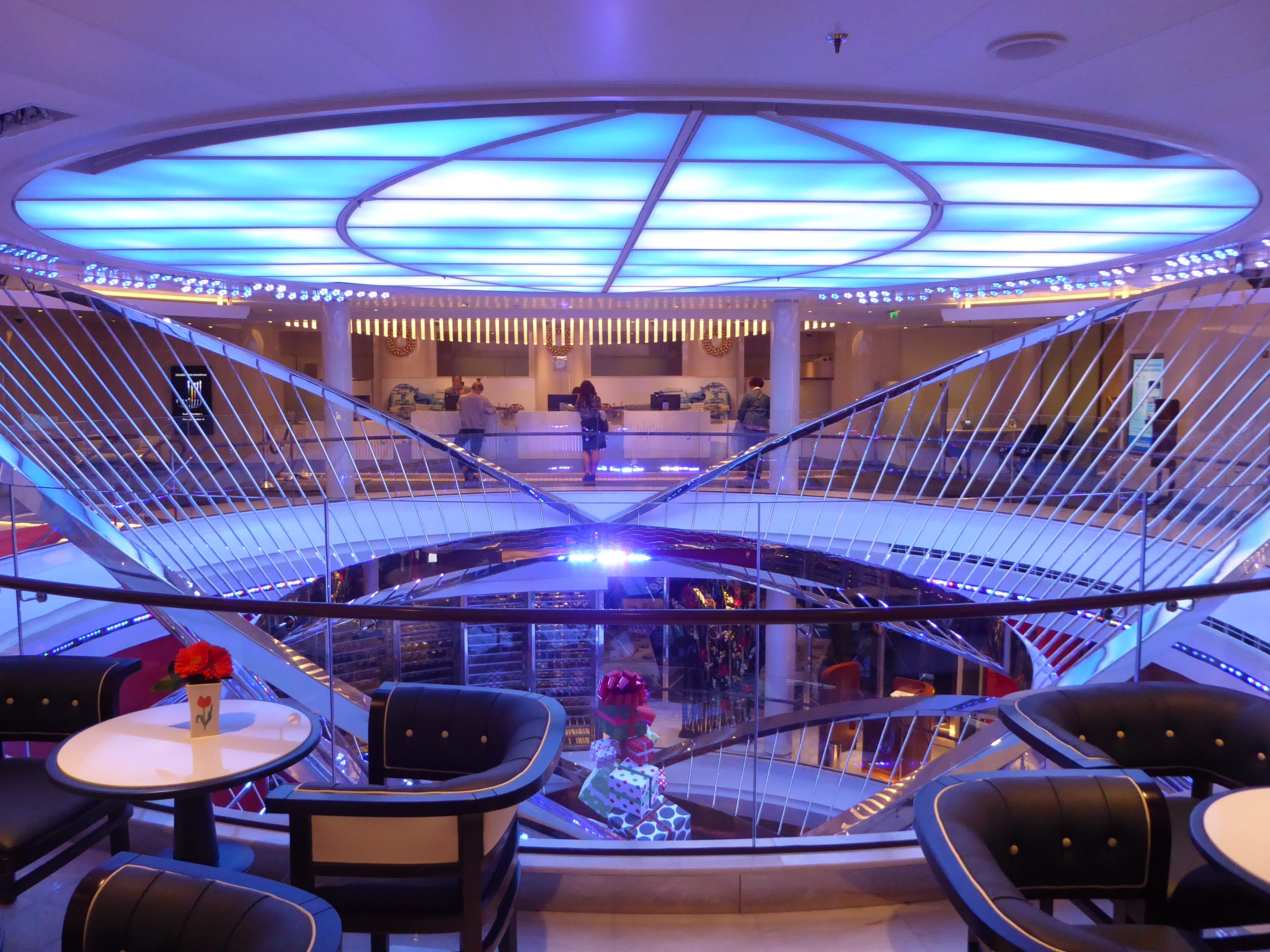 Conforming with the Nieuw Statendam's music-inspired decorative theme, a large metal sculpture representing the inner workings of a harp dominates the Atrium, a circular lobby that spans the midships portion of Decks 3, 2 and 1.