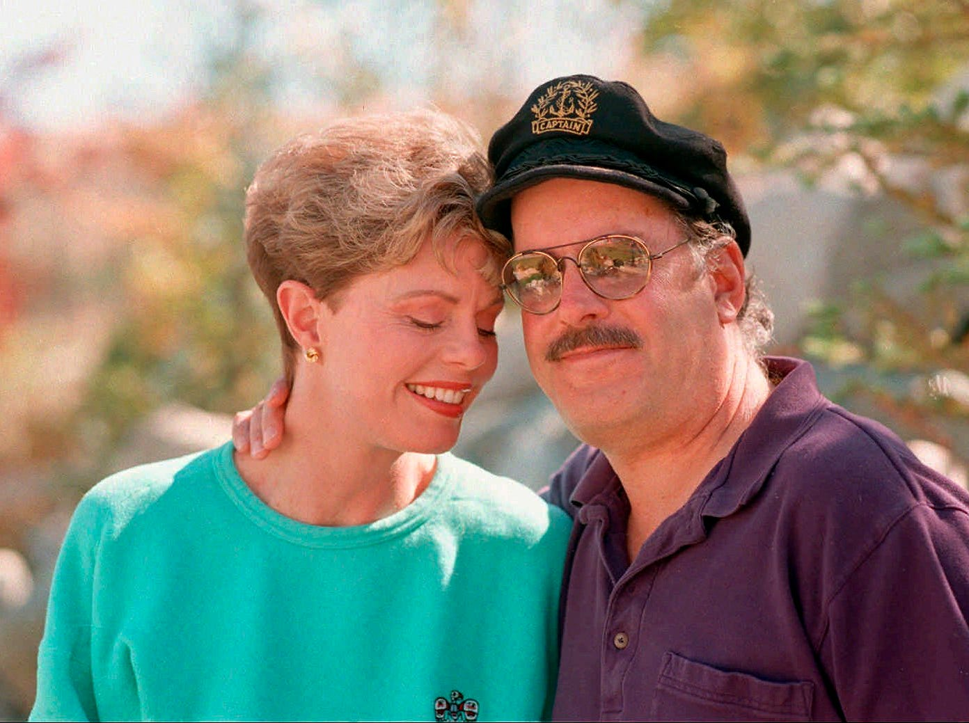 This Oct. 25, 1995 file photo shows Toni Tennille, left, and Daryl Dragon, the singing duo The Captain and Tennille, posing during an interview in at their home in Washoe Valley, south of Reno, Nev.  Dragon died early Wednesday, Jan. 2, 2019 in at a hospice in Prescott, Ariz. Spokesman Harlan Boll said he was 76 and died of renal failure. His former wife and musical partner, Toni Tennille, was by his side.