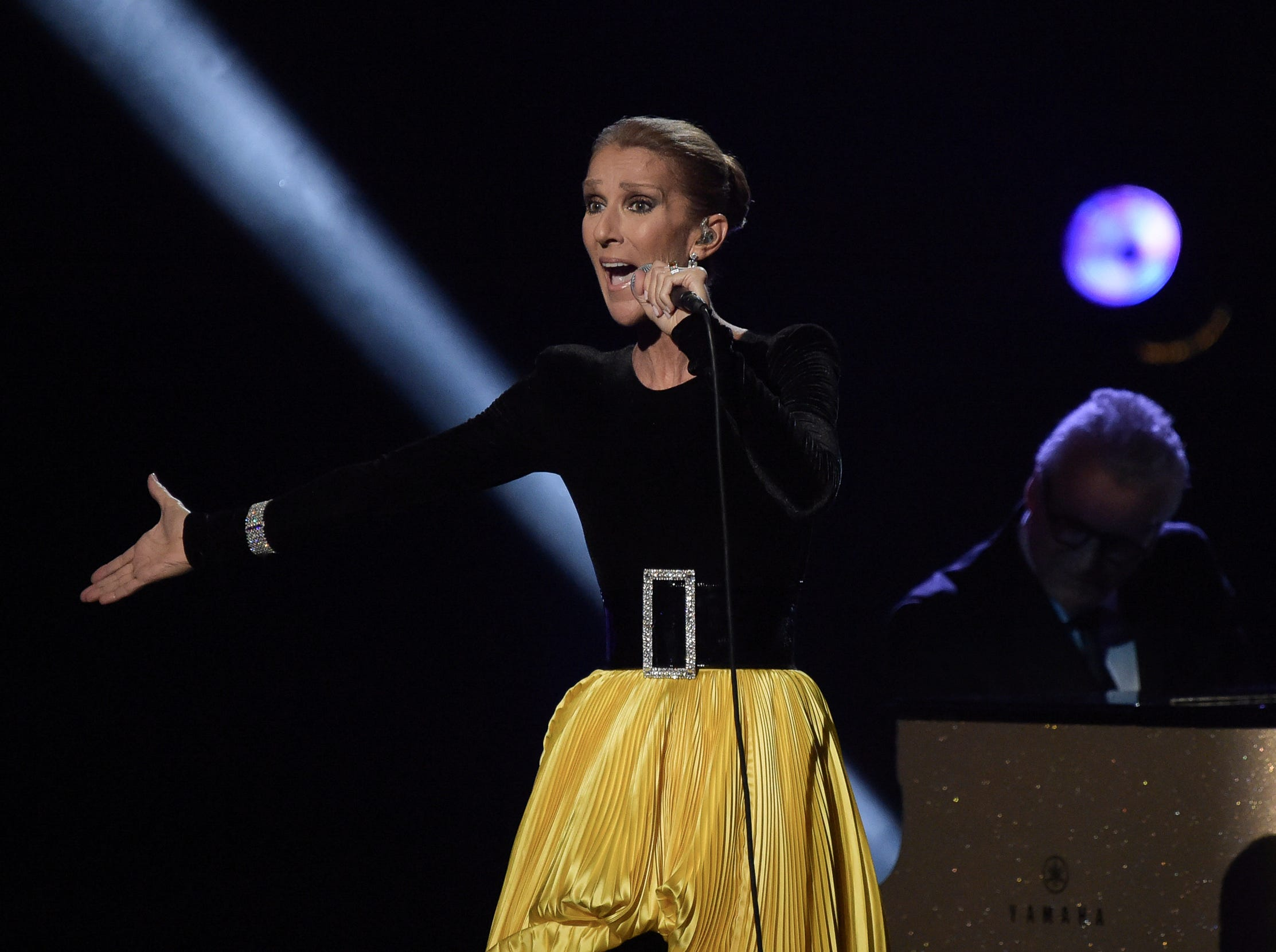 "Celine Dion performs at the ""Aretha! A Grammy Celebration For The Queen Of Soul"" event at the Shrine Auditorium on Sunday, January 13, 2019, in Los Angeles. The special is set to air on March 10, 2019. (Photo by Richard Shotwell/Invision/AP) ORG XMIT: CAPS102"