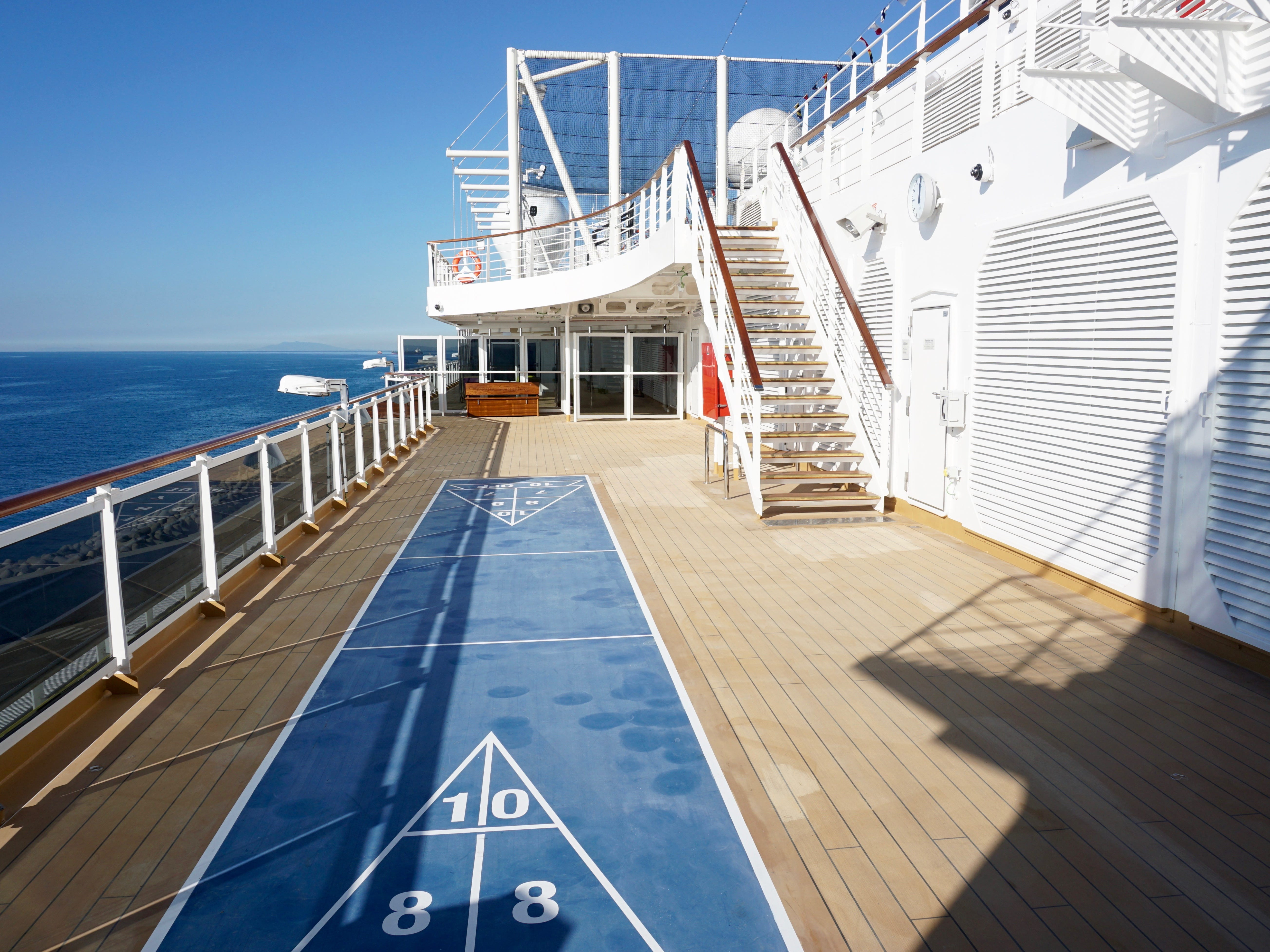 On either side of Deck 11, aft of the Lido Pool area, there are nooks with sunning space and shuffleboard courts.