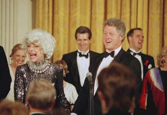 President Bill Clinton greets Carol Channing after she and several others provided entertainment at a White House dinner for the National Governors Association, Feb. 1, 1993 in Washington. The event was the first official dinner hosted by Clinton at the White House. Entertainer Linda Lavin is at rear. (AP Photo/Wilfredo Lee)