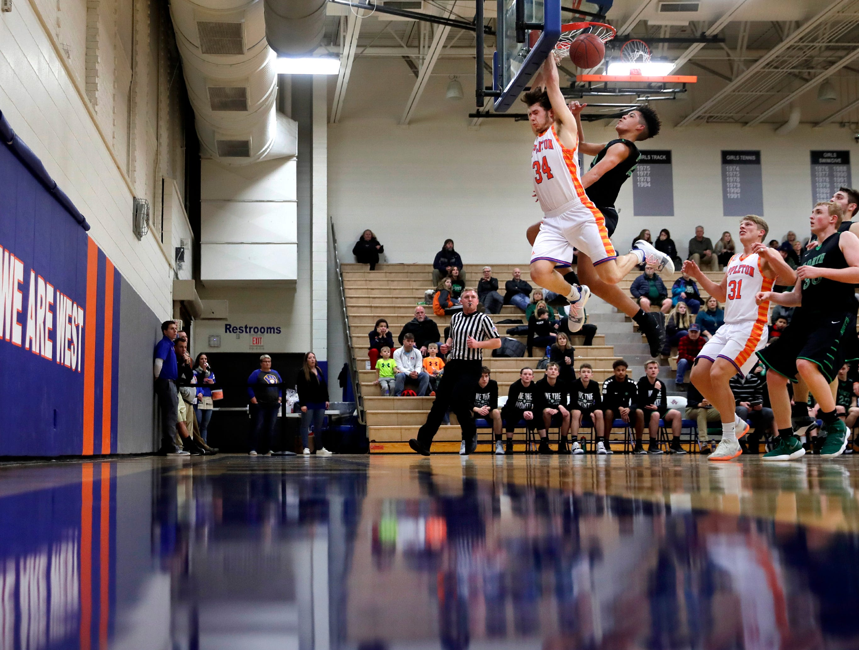 Appleton West High SchoolÕs Spencer Mellberg is fouled by Oshkosh North High SchoolÕs Jalen Keago as he goes for a dunk Tuesday, Jan. 15, 2019, at Appleton West High School in Appleton, Wis. Appleton West High School defeated Oshkosh North High School 72-63.Danny Damiani/USA TODAY NETWORK-Wisconsin