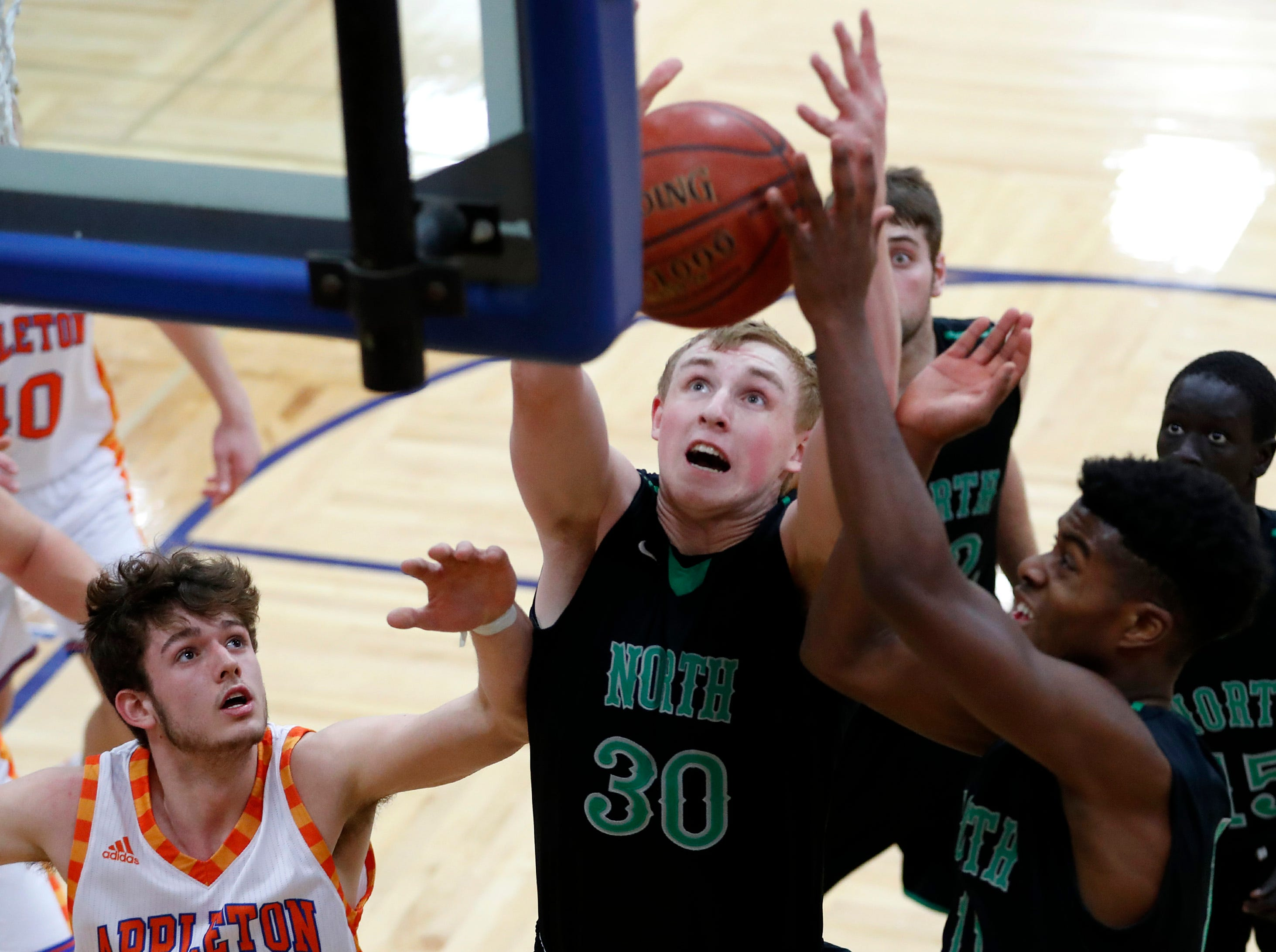 Oshkosh North High SchoolÕs Matthew Berger jumps for a rebound during their game against Appleton West High School Tuesday, Jan. 15, 2019, at Appleton West High School in Appleton, Wis. Appleton West High School defeated Oshkosh North High School 72-63.Danny Damiani/USA TODAY NETWORK-Wisconsin