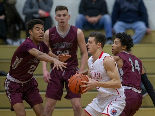 Wall's Quinn Calabrese (23) is surrounded by Matawan's Niles Halliburton (2), John Buekers (center) and Justyn Coleman (14) as he tries to make a play. Matawan Boys Basketball vs Wall in Wall NJ on January 15, 2019.