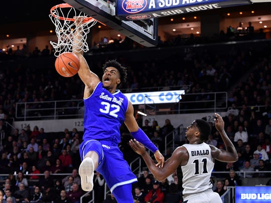 Seton Hall Pirates forward Darnell Brodie (32) dunks and scores in front of Providence Friars guard Alpha Diallo (11)