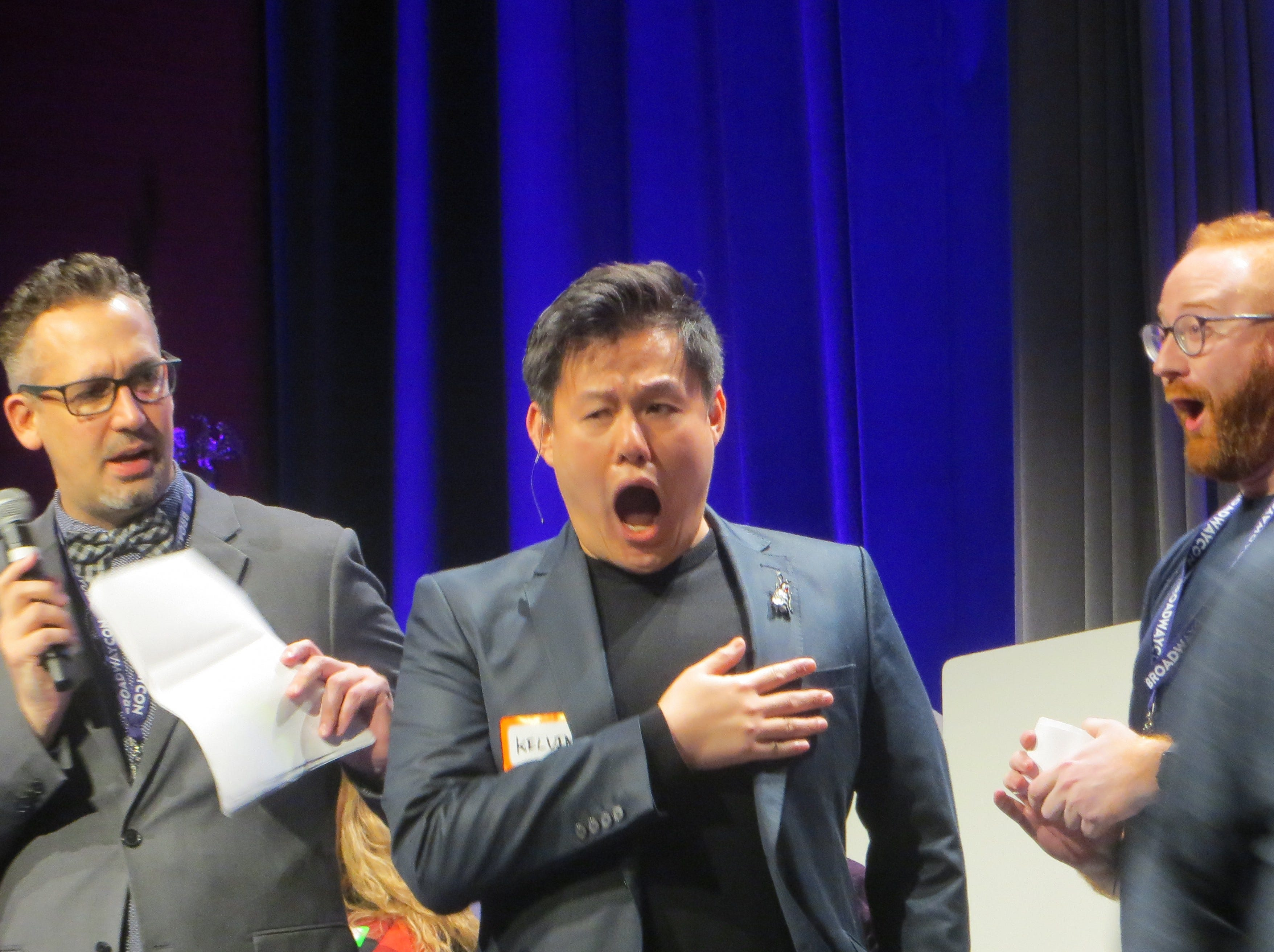 Ben Cameron, Kelvin Moon Loh and David Alpert react during Game Night  at BroadwayCon 2019, held Jan. 11 to 13, 2019, at the New York Hilton Midtown in Manhattan.