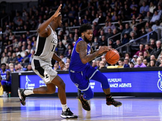 Seton Hall Pirates guard Myles Powell (13) drives to the basket against Providence Friars guard Alpha Diallo (11)