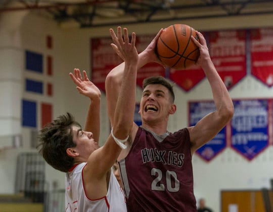 Matawan's John Buekers goes up with shot during first half action against Trey Dombroski. Matawan Boys Basketball vs Wall in Wall NJ on January 15, 2019.