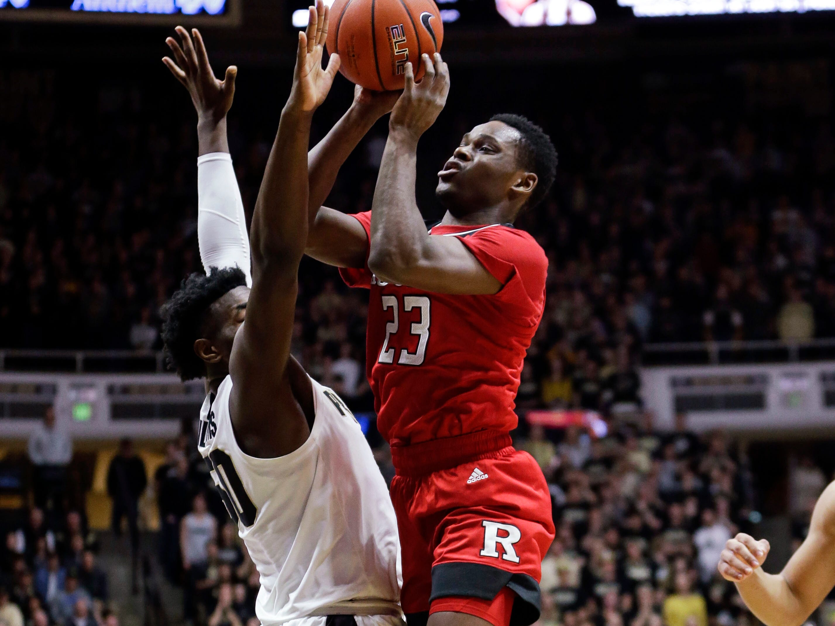 Rutgers guard Montez Mathis (23) shoots over Purdue forward Trevion Williams (50)