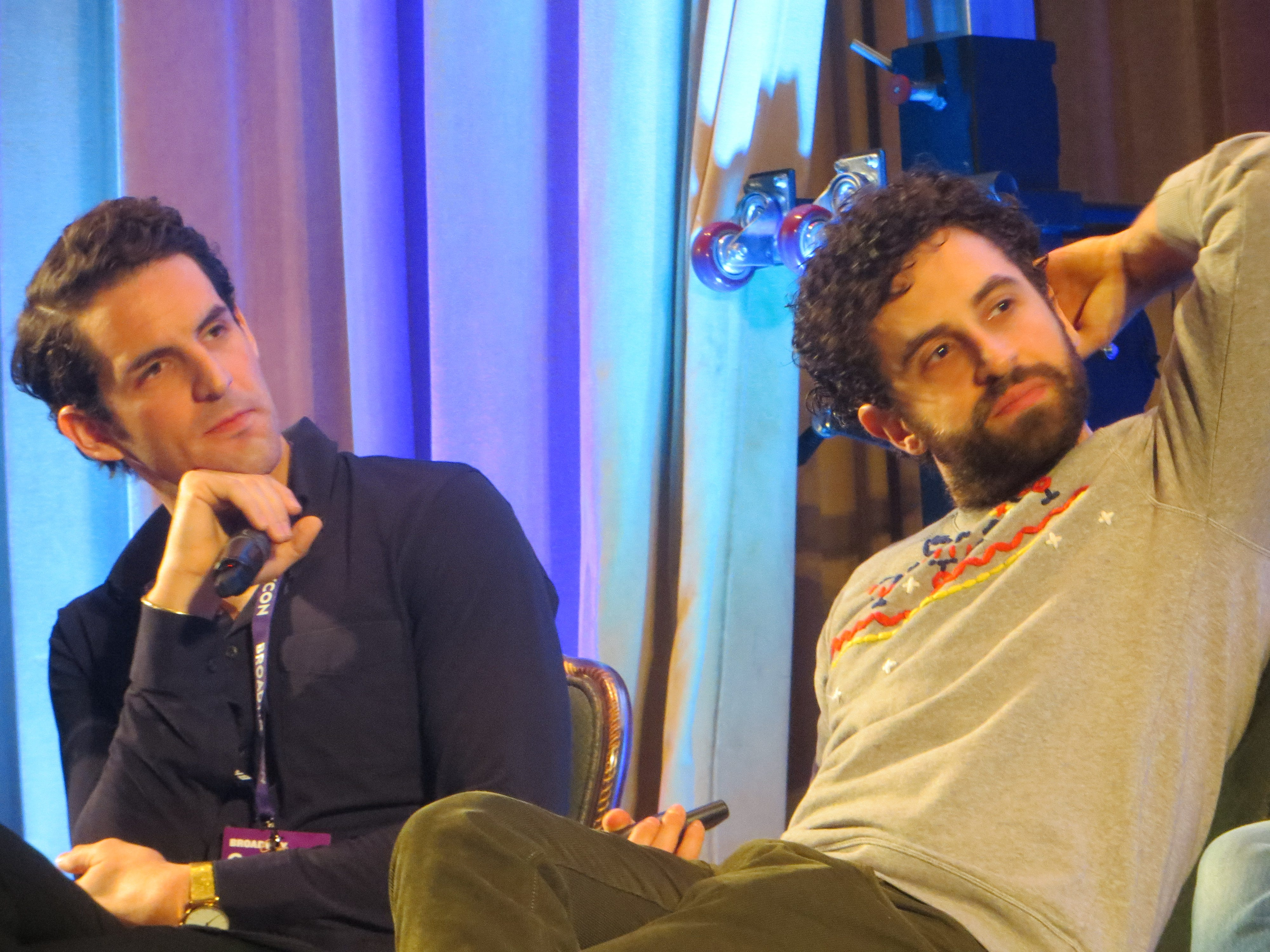 John Riddle and Brandon Uranowitz listen during the Out on Broadway panel at BroadwayCon 2019, held Jan. 11 to 13, 2019, at the New York Hilton Midtown in Manhattan.