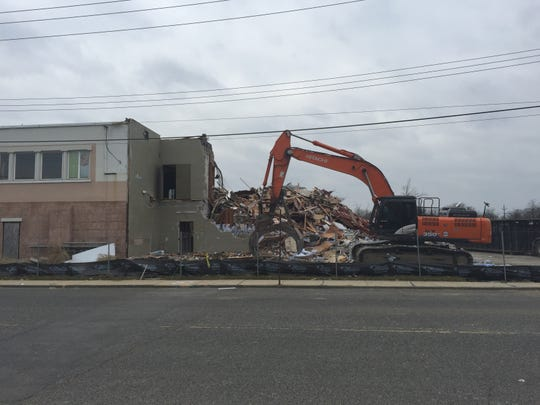 Demolition crews work to tear down a plaza at 200 Ocean Ave. in Long Branch on Jan. 16, 2019.
