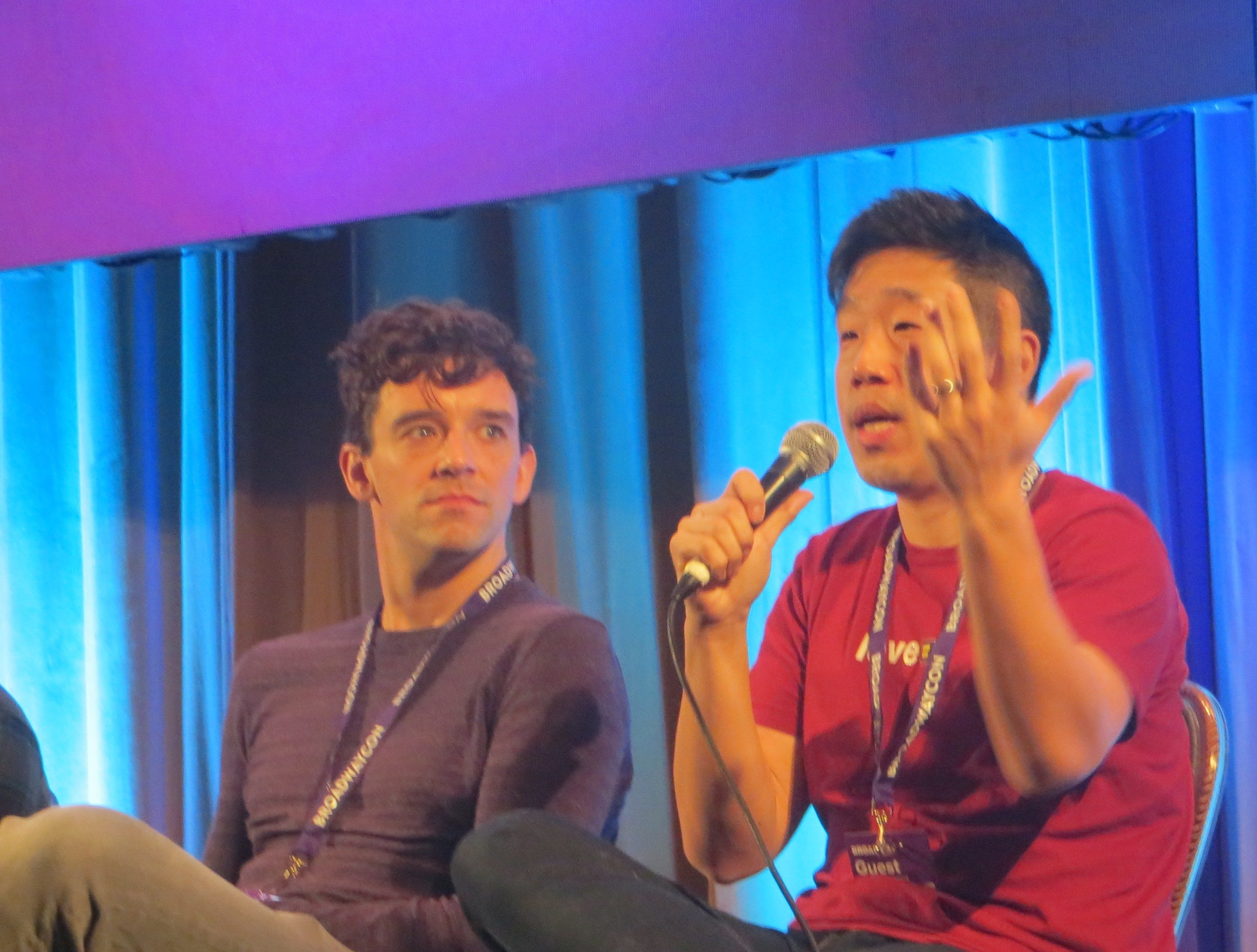 Michael Urie and Raymond Lee take part in the Out on Broadway panel at BroadwayCon 2019, held Jan. 11 to 13, 2019, at the New York Hilton Midtown in Manhattan.