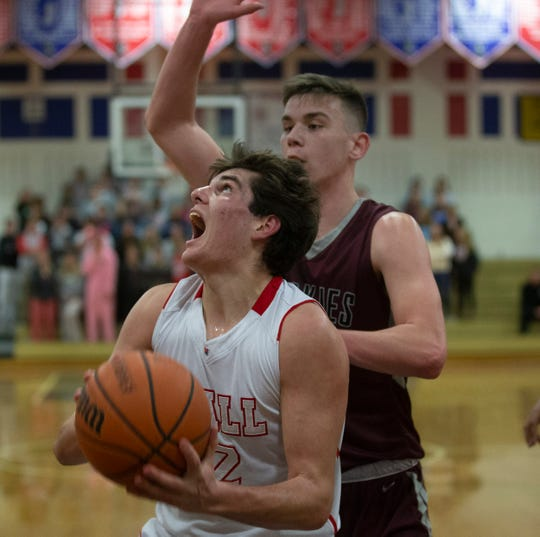 Wall's Trey Dombroski looks for some space to shoot under the basket during first half action. Matawan Boys Basketball vs Wall in Wall NJ on January 15, 2019.