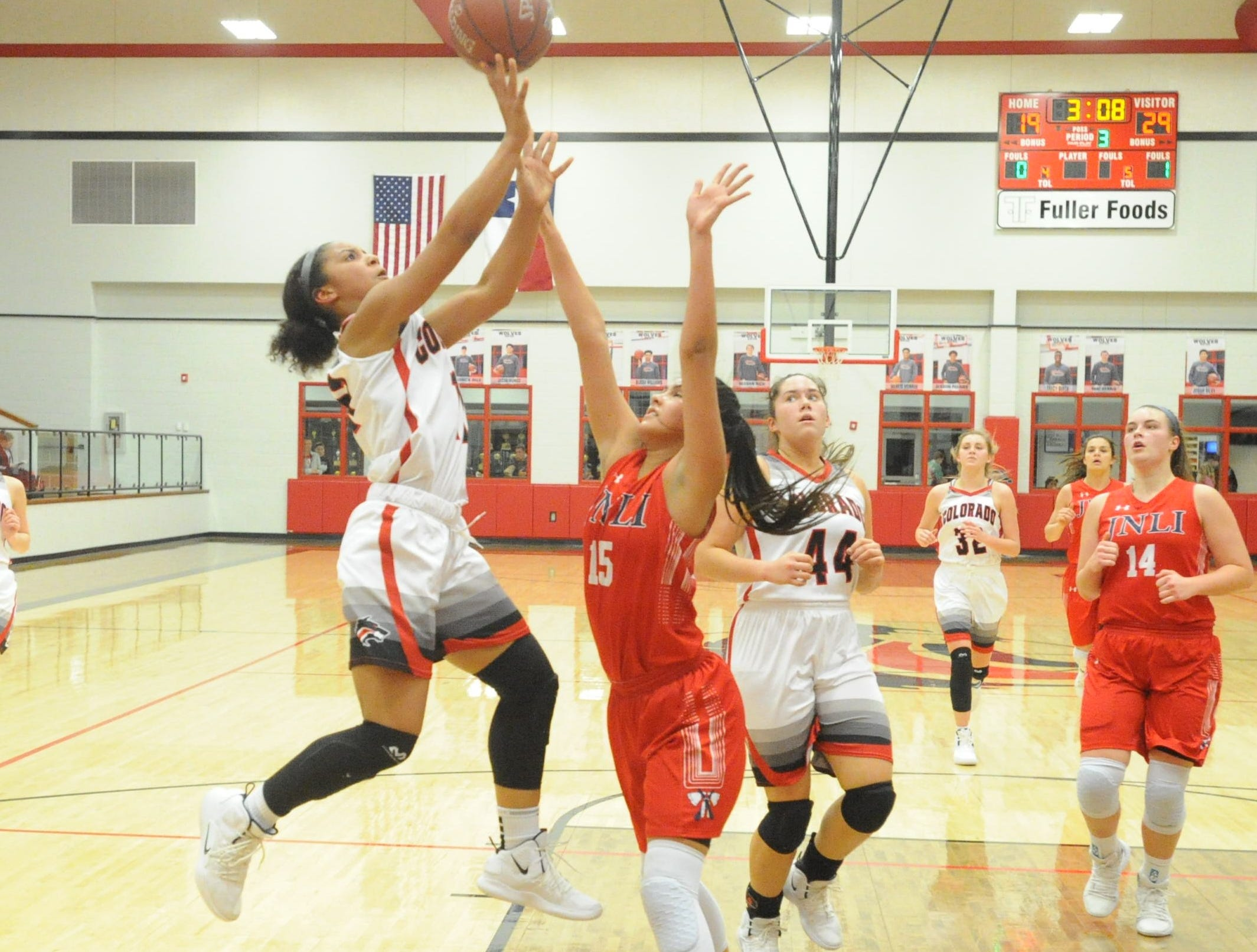 Colorado City guard Mia Monroe goes for a shot over Jim Ned's Alexis Espinosa.