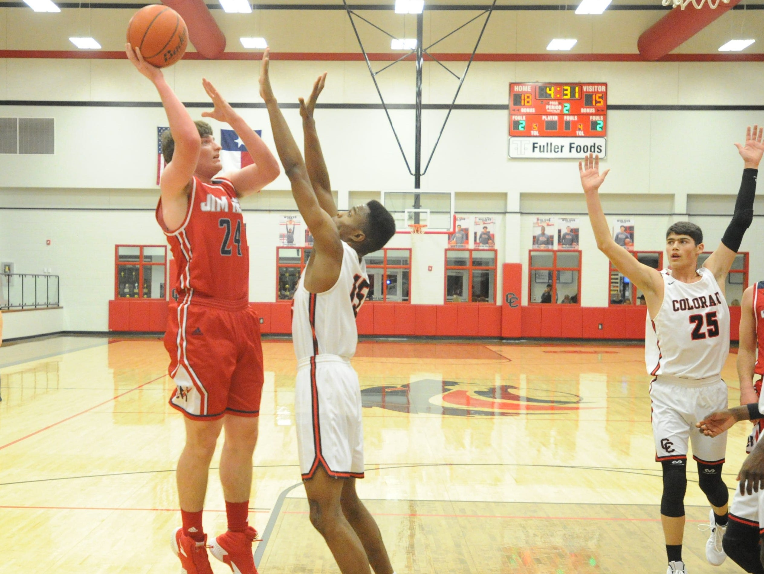 Jim Ned's Caden Burke goes for a hook shot over Colorado City post Omar Boone. The Indians topped the Wolves 46-41 at Colorado High School on Jan. 15, 2019.