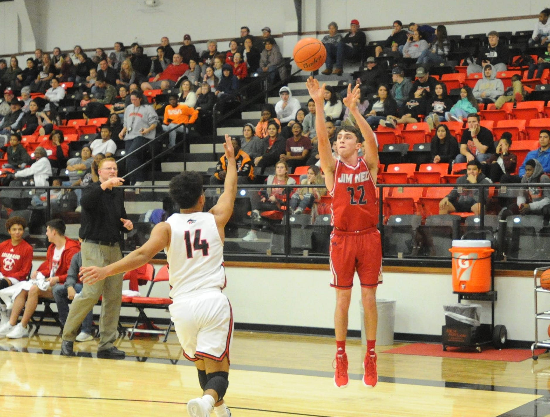 Jim Ned's Cade Ford takes a 3-pointer as Colorado City's Bubba Williams closes on defense. The Indians topped the Wolves 46-41 at Colorado High School on Jan. 15, 2019.
