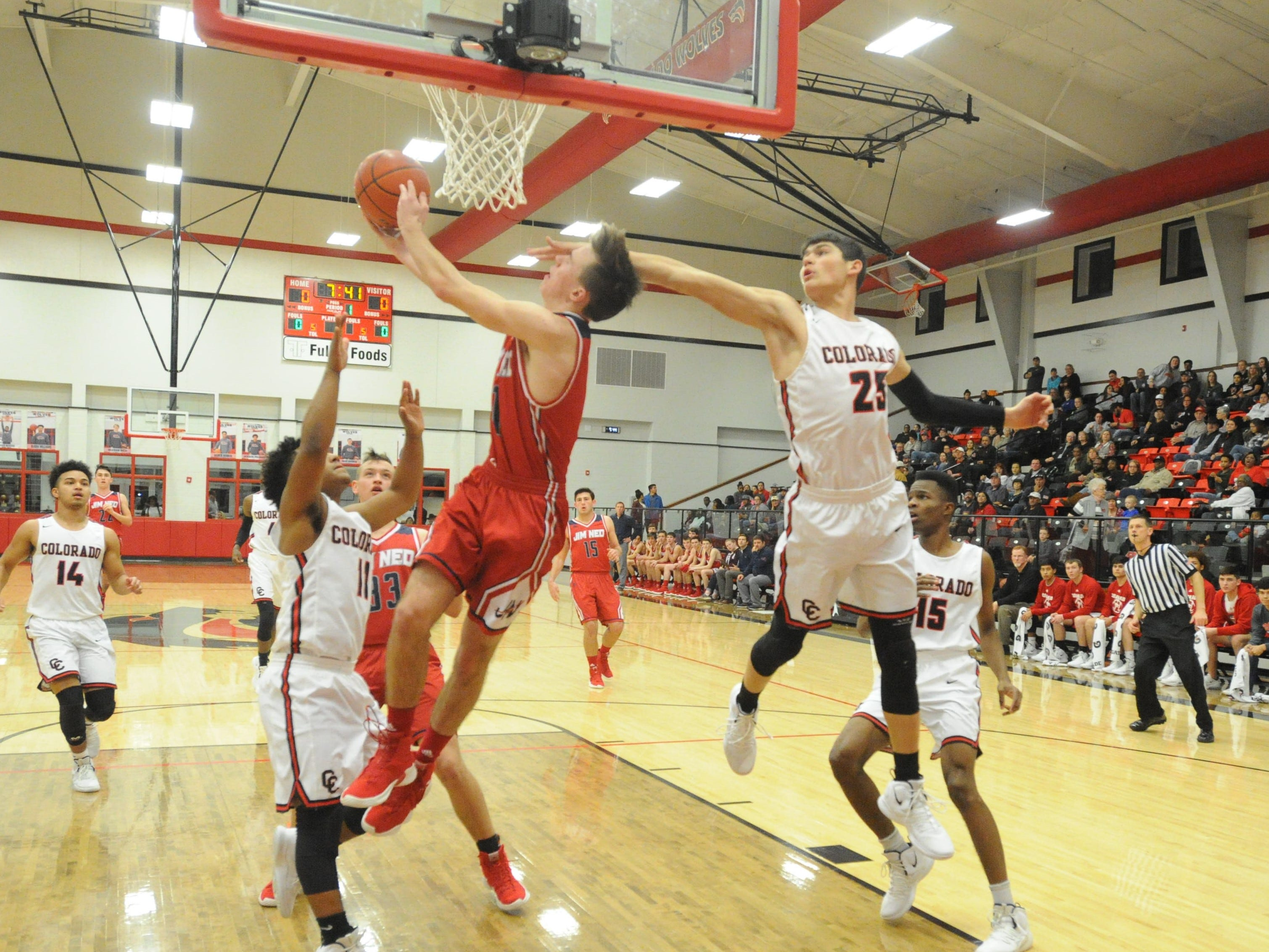 Colorado City post Maverick Hale hits Jim Ned's Caden Martin in the face as Martin attempts a reverse layup.