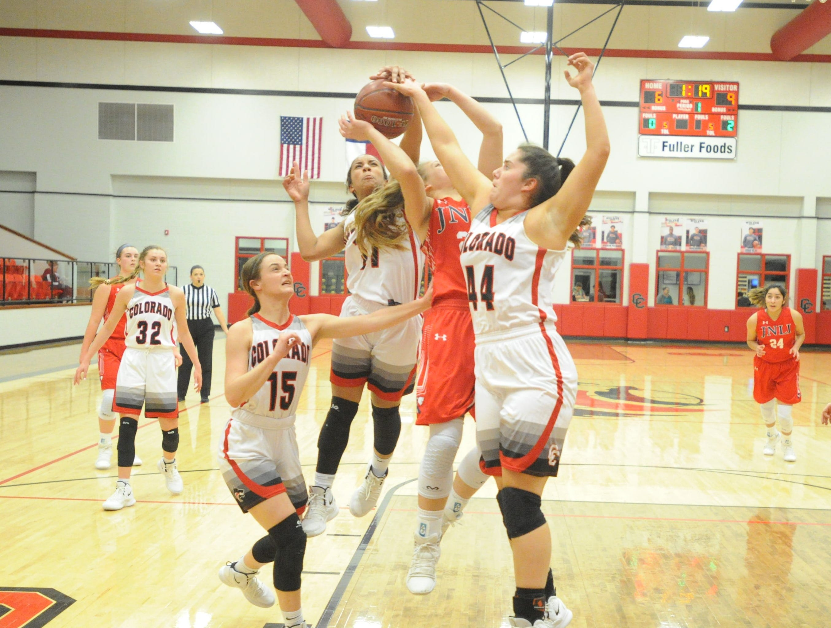 Colorado City players Mia Monroe (11) and Haley Bridges combine for a block on Jim Ned's Claire Graham. The Lady Indians topped the Lady Wolves 43-27 at Colorado High School on Jan. 15, 2019.