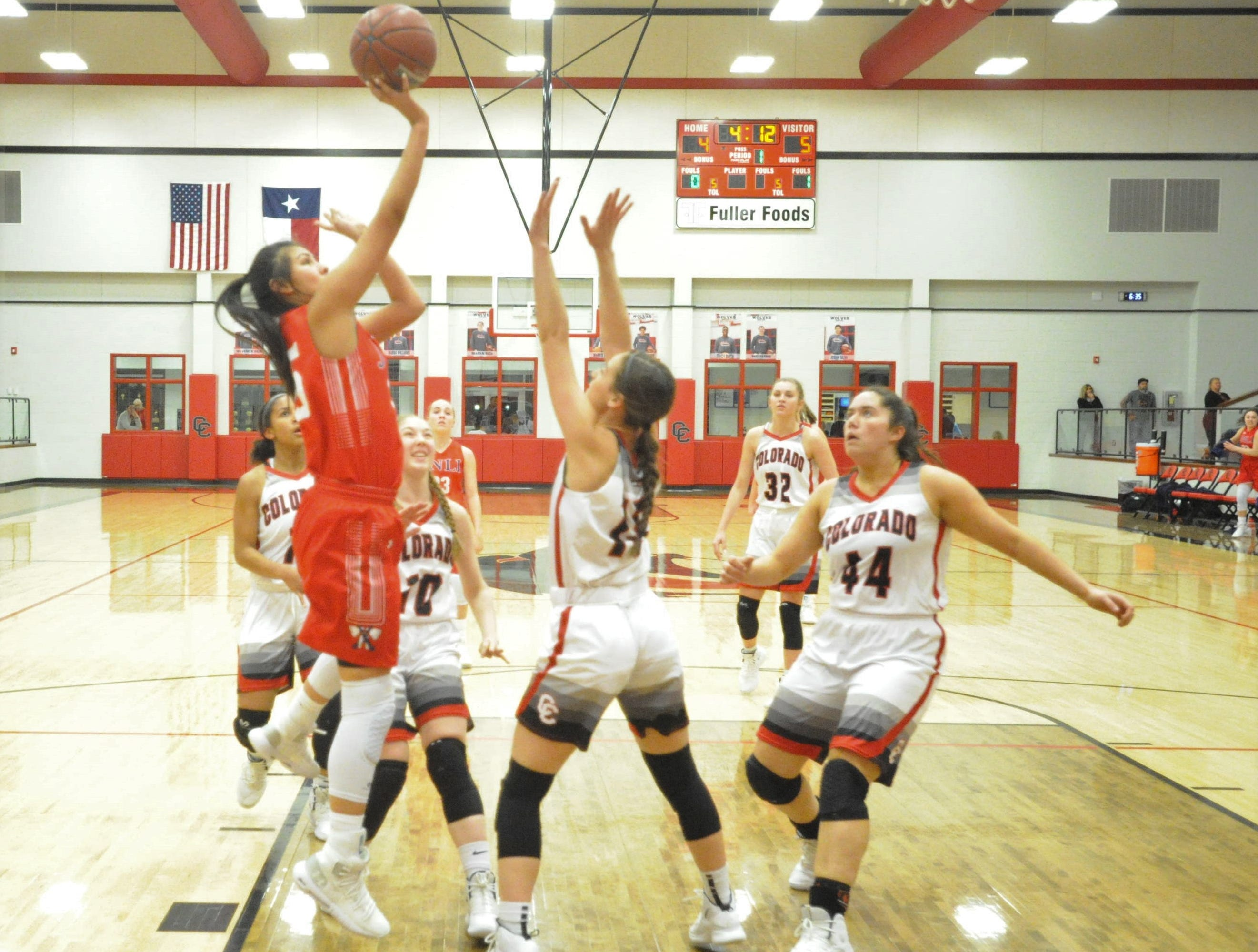 Jim Ned's Alexis Espinosa, left, goes for a shot in the lane in front of Colorado City guard Kaci Hudson. The Lady Indians topped the Lady Wolves 43-27 at Colorado High School on Jan. 15, 2019.