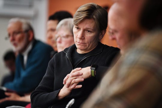 Asheville Police Chief Tammy Hooper listens to community members as they speak during the Asheville Citizens Police Action Committee meeting at the Dr. Wesley Grant Sr. Southside Center March 7, 2018.