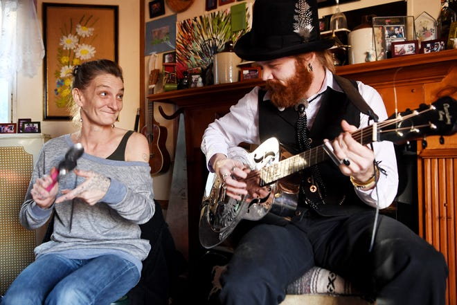 Abby Roach plays the spoons with Chris Rodrigues in Woodfin Jan. 15, 2019. The pair will play two sold-out shows this month at White Horse Black Mountain, a performing arts and event center.