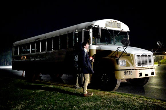 The Hendersonville basketball team boards the bus to head back to their high school from Canton after playing basketball at Pisgah High School. Often boys basketball games don't begin until 8 p.m. even on school nights.