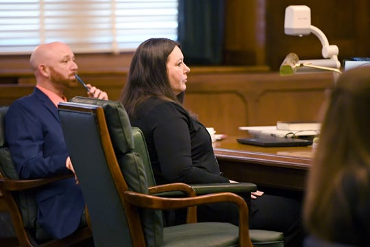 Robin Renee Richardson listens as her attorney gives opening statements during her trial for the 2015 murder of Timothy Fry, her boyfriend at the time, at the Buncombe County Courthouse on Jan. 16, 2019.