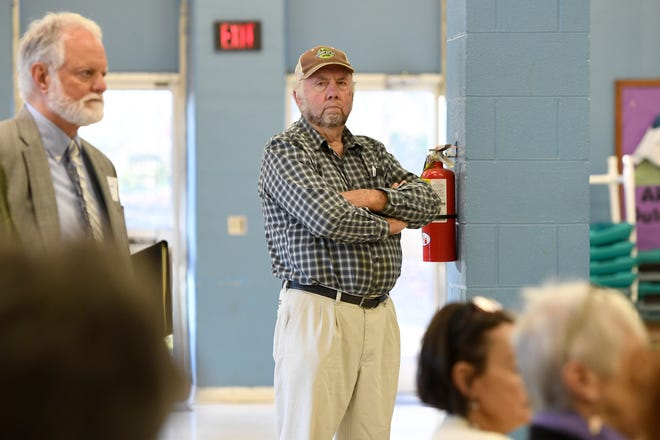 Representative John Ager listens as Attorney General Josh Stein announces that he does not object to HCA's purchase of Mission Health in a press conference at the Murphy-Oakley Recreation Center on Jan. 16, 2019.