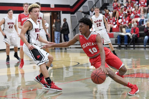 Hendersonville's Dwight Canady dribbles the ball past Pisgah's Devan Dodgin during their game at Pisgah High School on Jan. 15, 2019. The Bearcats defeated the Black Bears 77-55.