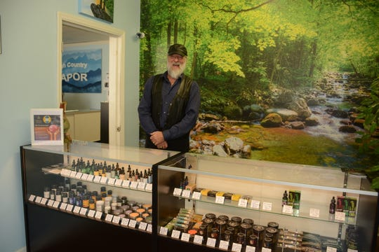 Owner of High Country Vapor and CBD Michael Williams stands behind the CBD counter in his Mars Hill store.