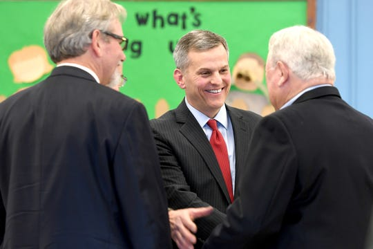North Carolina Attorney General Josh Stein meets attendees after announcing that he does not object to HCA's purchase of Mission Health in a press conference at the Murphy-Oakley Recreation Center on Jan. 16, 2019.
