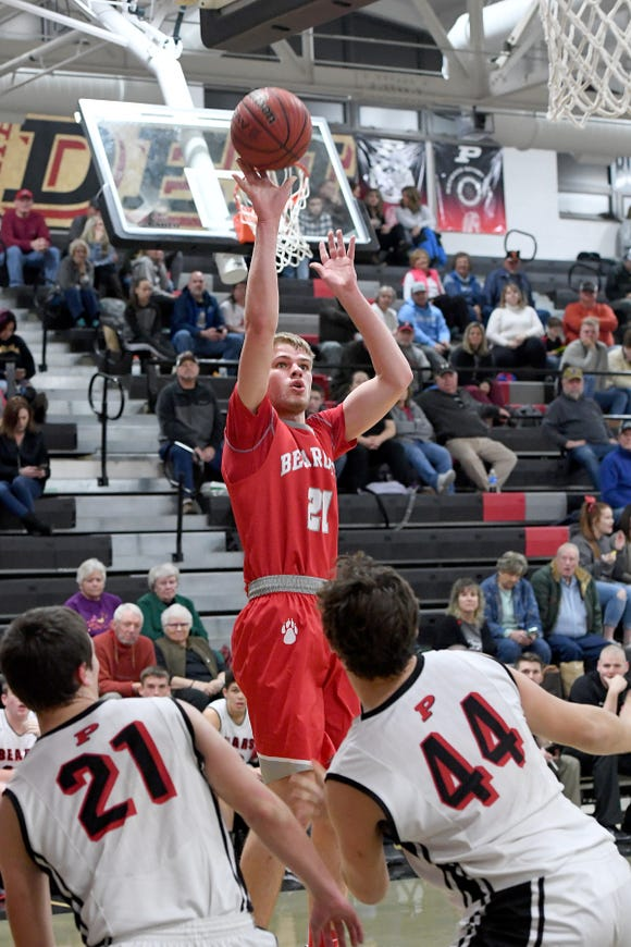 Hendersonville's Ben Beeker goes up for a shot against Pisgah's Hunter Davis, left, and Neyland Walker during their game at Pisgah High School on Jan. 15, 2019. The Bearcats defeated the Black Bears 77-55.