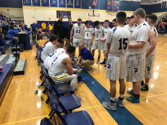 Coach Ocker chatting up the boys after M-E halved a 10-point second-quarter deficit.