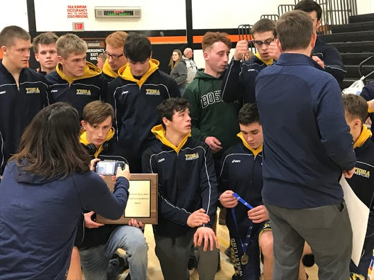 Tioga wrestlers receive their medals after winning the Section 4 Division II Dual Meet Tournament on Tuesday at Walton.