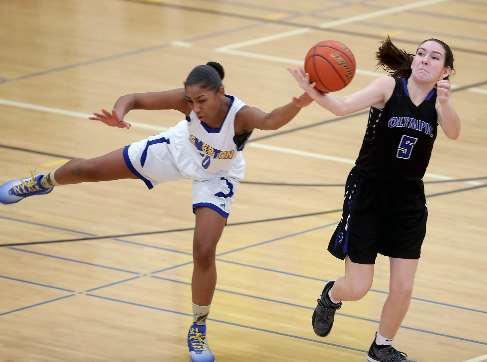 The Bremerton girls basketball team hosted Olympic on Tuesday, January, 15, 2019. Olympic won the game. Bremerton's Shauntay Levingston, left, tries to steal the pass to Olympic's Chloe Ashcraft.