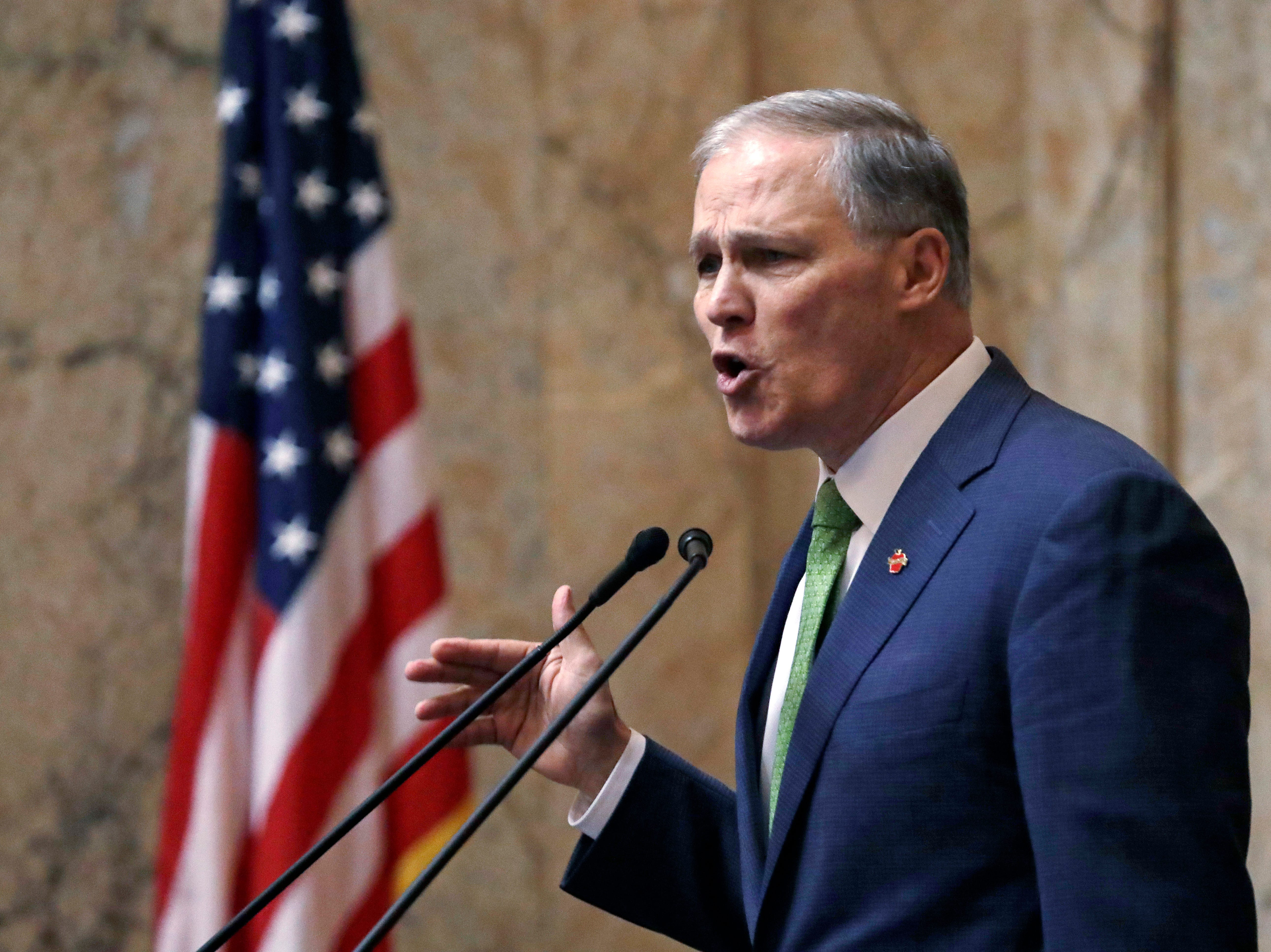 Gov. Jay Inslee gives his State of the State address Tuesday in Olympia. Inslee, who is mulling a 2020 White House bid, highlighted his clean energy agenda in the annual speech. (AP Photo/Elaine Thompson)