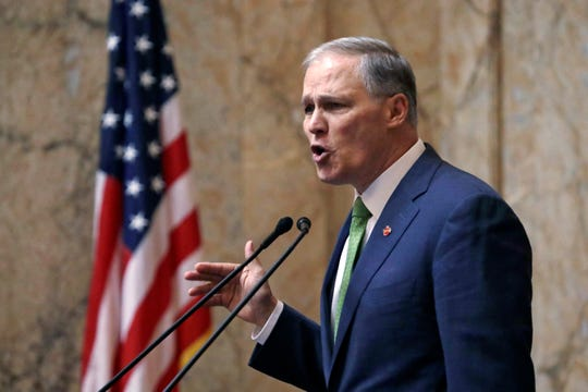 Gov. Jay Inslee gives his 2019 State of the State address in Olympia.  (AP Photo/Elaine Thompson)