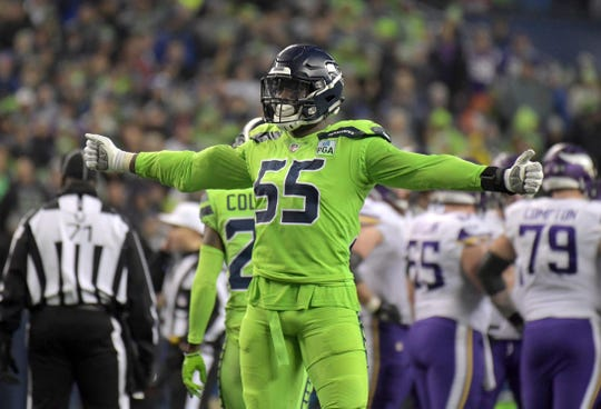 Seahawks defensive end Frank Clark celebrates a big play during a December win over the Vikings in Seattle. Clark reportedly tore the ulnar collateral ligament in his elbow during that game.