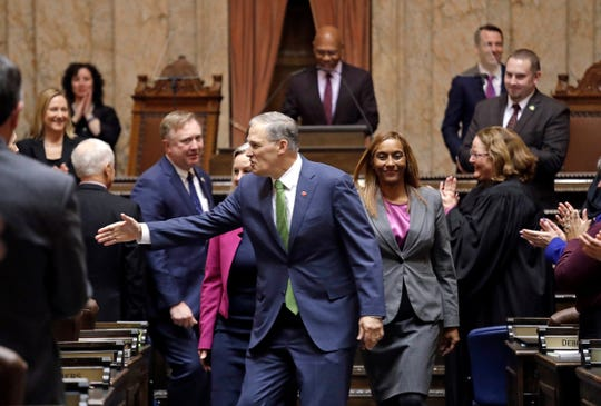 Gov. Jay Inslee greets legislators following his State of the State address.